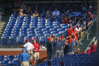 Philadelphia Phillies' ground crew pull the rope to fix the safety netting that snapped during the eighth inning of a baseball game against the Washington Nationals, Sunday, June 6, 2021, in Philadelphia. (AP Photo/Chris Szagola)