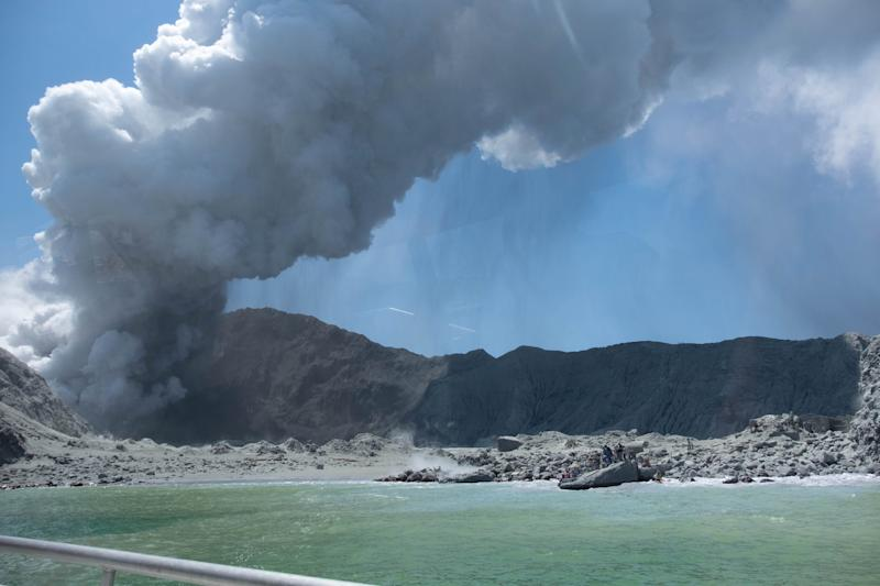 NB - Please note mandatory credit 'Michael Schade' View of the eruption on White Island, one of an incredible series of pictures and videos captureds by tourist Michael Schade who managed to leave the island minutes after it exploded, December 9 2019. His pictures who White Island Tour operators rescuing people around 12-14 minutes after eruption and he tweeted his gratitude to the crew for stepping up as first responders.