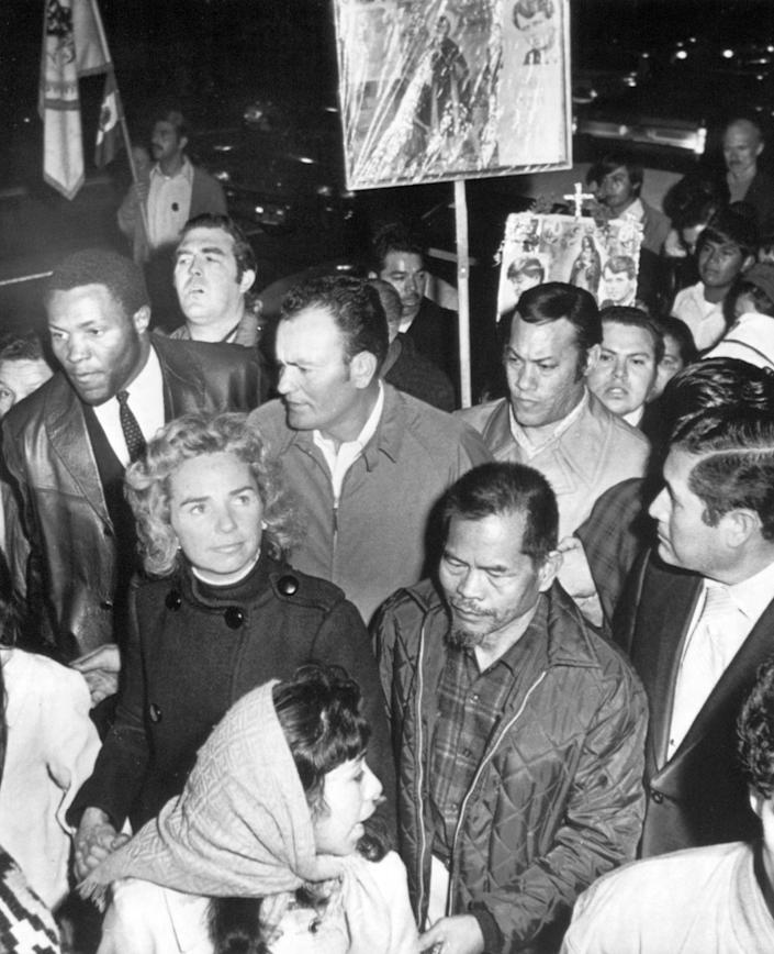 Ethel Kennedy and Rafer Johnson join the march to the jail in Salinas to visit labor leader Cesar Chavez.