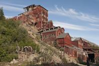 "<p>The former copper mining town of Kennecott, Alaska is a remarkably well-preserved ghost town that is now <a href=""https://www.nps.gov/wrst/learn/historyculture/upload/Kennecottbulletin.pdf"" rel=""nofollow noopener"" target=""_blank"" data-ylk=""slk:part of the National Park Service"" class=""link rapid-noclick-resp"">part of the National Park Service</a>. First <a href=""https://www.nps.gov/wrst/learn/historyculture/upload/Kennecottbulletin.pdf"" rel=""nofollow noopener"" target=""_blank"" data-ylk=""slk:settled in 1903"" class=""link rapid-noclick-resp"">settled in 1903</a> by the Kennecott Mining Corporation, five mines operated in the area attracting miners and their families from other parts of the country. Within a few years,<a href=""https://www.nps.gov/wrst/learn/historyculture/kennecott-mines-national-historic-landmark.htm"" rel=""nofollow noopener"" target=""_blank"" data-ylk=""slk:Kennecott grew into a bustling, self-sufficient company town t"" class=""link rapid-noclick-resp""> Kennecott grew into a bustling, self-sufficient company town t</a>hat housed 300 people as well as a hospital, general store, school, skating rink, tennis court, recreation hall and dairy. However, by the 1920s, the copper mines started to become depleted, and by 1938 the town was abandoned. During its time in operation,<a href=""https://www.nps.gov/wrst/learn/historyculture/kennecott-mines-national-historic-landmark.htm"" rel=""nofollow noopener"" target=""_blank"" data-ylk=""slk:almost $200 million worth of copper"" class=""link rapid-noclick-resp""> almost $200 million worth of copper</a> was processed.</p><p>After sitting uninhabited for decades, in 1978, Kennecott was listed on the National Register of Historic Places, and in 1986 it was designated as a National Historic Landmark. In 1998, the National Park Service acquired many of the structures in the former company town and some of the surrounding land. </p><p>Open each year from Memorial Day to Labor Day, visitors can take <a href=""https://www.steliasguides.com/trips/kennecott-mill-town-tour/"" rel=""nofollow noopener"" target=""_blank"" data-ylk=""slk:guided tours of Kennecott,"" class=""link rapid-noclick-resp"">guided tours of Kennecott,</a> including the 14-story mill and many of the other structures, complete with former residents' personal possessions they left behind.</p>"