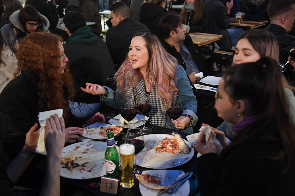 Diners enjoying a pizza after the restrictions were eased on MondayJeremy Selwyn
