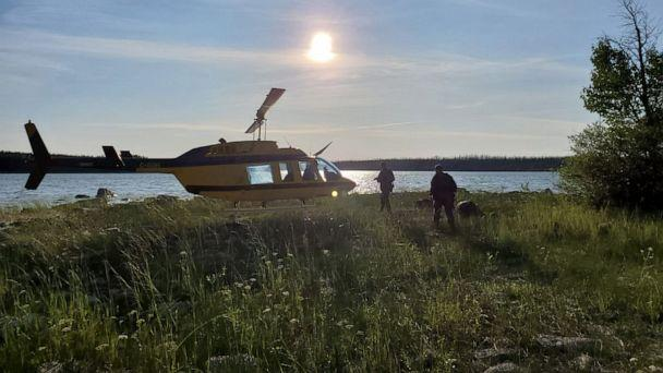 PHOTO: A handout photo made available by the Royal Canadian Mounted Police shows a RCMP officers boarding a helicopter to conduct a search in the Gilliam area of Manitoba, Canada, July 28, 2019. (RCMP/HANDOUT/EPA-EFE/REX)