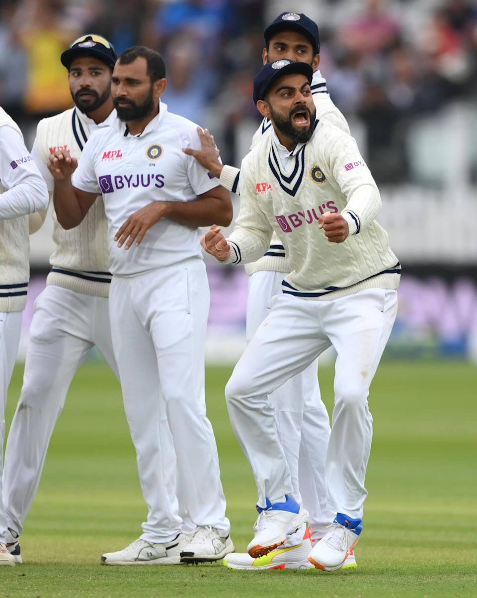 <p>LONDON, ENGLAND - AUGUST 16: India captain Virat Kohli celebrates after the wicket of Dom Sibley during day five of the second Test Match between England and India at Lord's Cricket Ground on August 16, 2021 in London, England. (Photo by Stu Forster/Getty Images)</p>