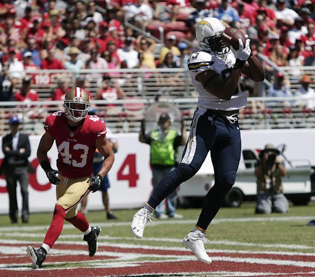 San Diego Chargers tight end Antonio Gates, right, catches a 10-yard touchdown pass in front of San Francisco 49ers strong safety Craig Dahl (43) during the first quarter of an NFL preseason football game in Santa Clara, Calif., Sunday, Aug. 24, 2014. (AP Photo/Marcio Jose Sanchez)