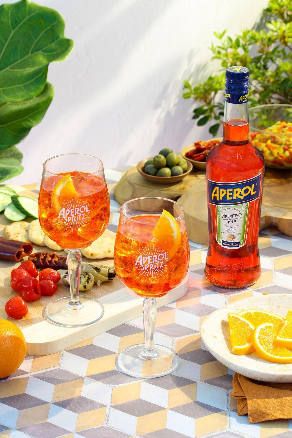 <p>This wildly popular drink can be pretty divisive, as most imbibers either love it or love to hate it. It's a bittersweet, bubbly beverage that is low in alcohol and high in enlivening a summer afternoon.</p><p><strong>Ingredients</strong></p><p>Ice cubes </p><p> Aperol </p><p> Prosecco</p><p>Soda, served from syphon or chilled bottle </p><p>Orange slice, for garnish.</p><p><strong>Directions</strong></p><p>In a glass full of ice, combine Prosecco and Aperol in equal parts. Add a splash of soda and garnish with an orange slice.</p>