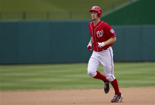 Washington Nationals' Stephen Strasburg (37) rounds the bases after hitting his first career home run during the fourth inning of an interleague baseball game against the Baltimore Orioles in Washington, Sunday, May 20, 2012. (AP Photo/Manuel Balce Ceneta)
