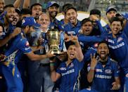 Mumbai Indians, led by Rohit Sharma, have won the last two editins of the IPL and are among the favourites again when this year's virus-interrupted tournament resumes (AFP/NOAH SEELAM)