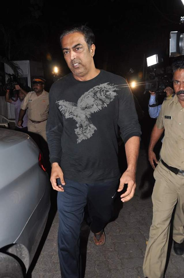 Vindoo Dara Singh walks away after talking to reporters following his release on bail in Mumbai on June 4. (Sanskrity Media)