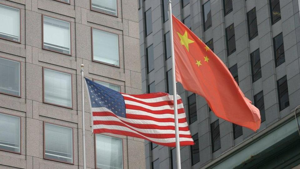 The US and the Chinese national flags flying side by side