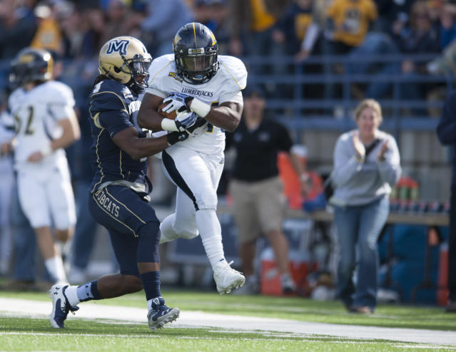 In this image provided by Montana State University, Northern Arizona running back Zach Bauman (34) wrestles past Montana State's Sean Gords (3) during the second quarter of an NCAA college football game Saturday, Oct. 5, 2013 in Bozeman, Mont. (AP Photo/Montana State University, Kelly Gorham)