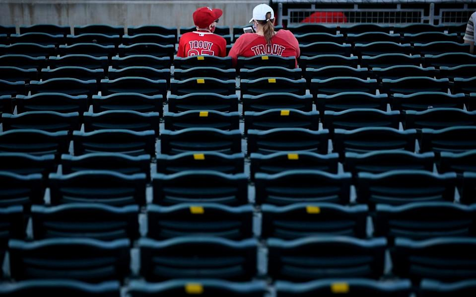 Angels fans watch warmups Tuesday before a game against the Reds at spring training in Goodyear, Ariz.