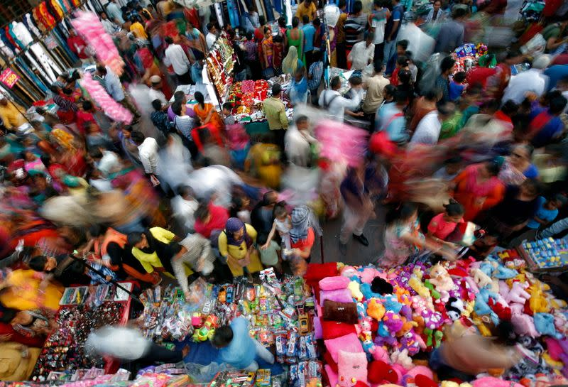 FILE PHOTO: Shoppers crowd at a market place ahead of Diwali in Ahmedabad