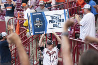 Virginia's Andrew Abbott holds up a sign for the College World Series after an NCAA college baseball tournament super regional game against Dallas Baptist, Monday, June 14, 2021, in Columbia, S.C. (AP Photo/Sean Rayford)