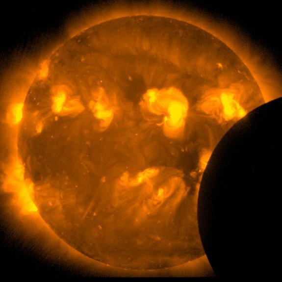 This image, taken by the sun-watching Hinode satellite, was taken two minutes after the start of the annular solar eclipse on May 20, 2012.