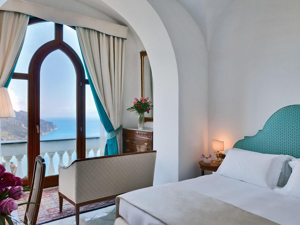 A grand villa dating back to the 12th century, Palazzo Avino, in Ravello's former aristocratic quarter, has long been considered the top spot in town. The rooms are outfitted in handcrafted Vietri tiles, 18th-century Italian antiques, brass accessories, and Frette linens. At Rossellinis Restaurant, you can enjoy dinner—either a la carte or as a tasting menu—on the terrace as you look down on fishing boats one thousand feet below. Caffé dell'Arte, with its white marble floor, serves casual regional cuisine. If you're in the mood for something decadent, the Lobster & Martini Bar is exactly what it promises, with fresh local lobster paired with Champagne or prosecco, and a 70-strong menu of martinis, all of it with a view of the sunset over the sea.