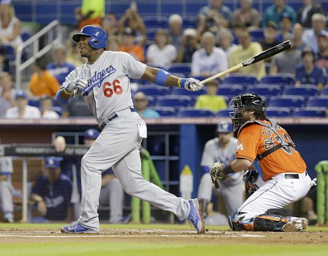 Los Angeles Dodgers' Yasiel Puig (66) reacts after striking out during the first inning of a baseball game against the Miami Marlins, Sunday, May 4, 2014, in Miami. (AP Photo/Wilfredo Lee)
