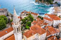 """It's not easy to find an uncrowded beach in Europe during the summer months, but the country of <a href=""""https://www.cntraveler.com/story/get-to-montenegro-nowbefore-everyone-else-does?mbid=synd_yahoo_rss"""" rel=""""nofollow noopener"""" target=""""_blank"""" data-ylk=""""slk:Montenegro"""" class=""""link rapid-noclick-resp"""">Montenegro</a> is one of your best bets. It takes up less space than Connecticut and has a lower population than Stockholm, but the tiny Balkan nation should not be overlooked—especially since it's quieter and more untouched than neighbors Croatia and Greece. Beyond the beaches, you can take advantage of the country's historic Old Towns, UNESCO-protected parks, and lakes begging for a swim. The country is currently open to all travelers who provide a negative COVID-19 test within 72 hours of arrival (vaccinated travelers do not need to take a test, but must how that vaccination occurred at least seven days prior to arrival). Now hurry up and get there before everyone else starts to catch on."""