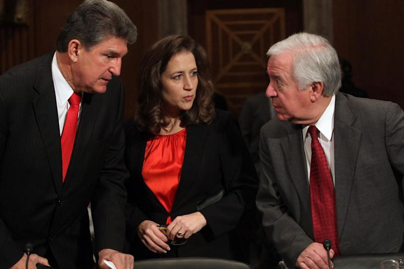 From left, Sen. Joe Manchin, D-W.Va., West Virginia Secretary of State Natalie Tennant, and Rep. Nick Rahall, D-W.Va. confer on Capitol Hill in Washington, Tuesday, Feb. 4, 2014, prior to testifying before the Senate subcommittee on Water and Wildlife hearing to examine the safety and security of drinking water supplies following the Central West Virginia drinking water crisis. (AP Photo/Lauren Victoria Burke)