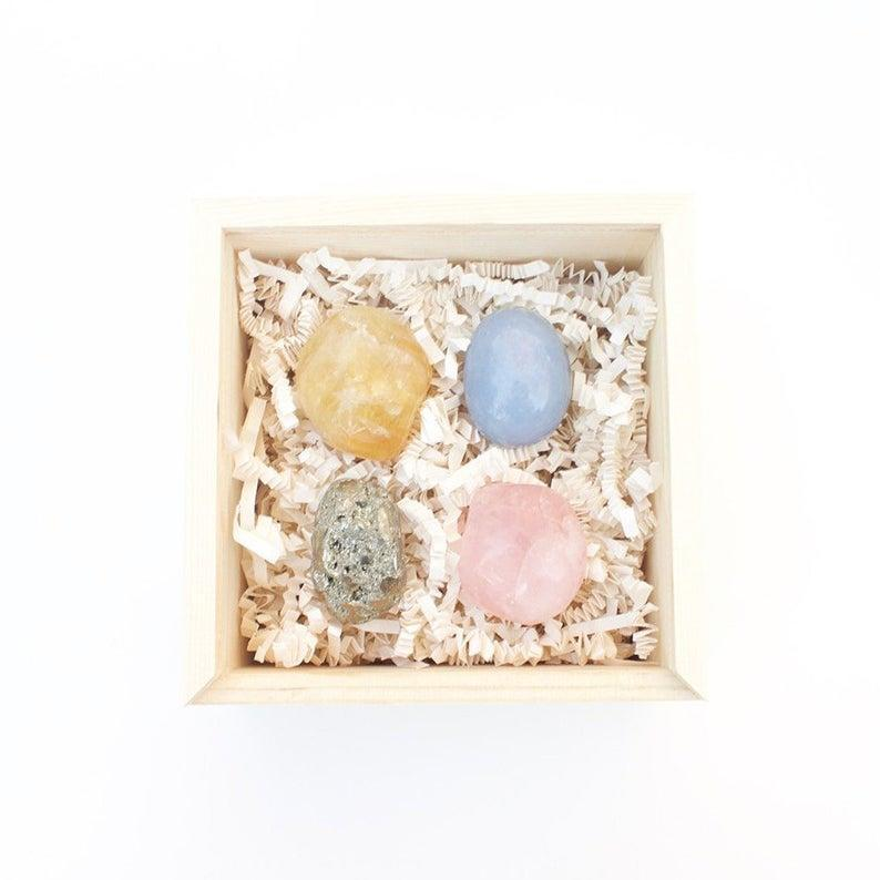 """<h3><strong>Good Vibes Healing Stone Set</strong></h3><br>This set of four healing stones comes packaged in a pine-wood gift box and is specially curated to foster good vibes and positive karma for the most special of recipients. <br><br><strong>CrystalandPineShop</strong> Good Vibes Healing Stones Set, $, available at <a href=""""https://go.skimresources.com/?id=30283X879131&url=https%3A%2F%2Fwww.etsy.com%2Flisting%2F634979027%2Fgood-vibes-healing-stones-set-hostess"""" rel=""""nofollow noopener"""" target=""""_blank"""" data-ylk=""""slk:Etsy"""" class=""""link rapid-noclick-resp"""">Etsy</a>"""