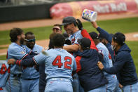 Minnesota Twins' Max Kepler, center with helmet, celebrates with his team after driving in the winning run in the ninth inning of a baseball game against the Boston Red Sox, Thursday, April 15, 2021, in Minneapolis. The Twins won 4-3. (AP Photo/Craig Lassig)