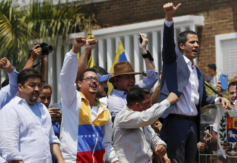 In this Saturday, March 16, 2019 photo, lawyer Roberto Marrero, left, attends a rally with Venezuelan opposition leader Juan Guaido, right, who has declared himself interim president in Valencia, Venezuela. Venezuelan security forces detained Marrero, a key aide to Guaido in a raid on his home early Thursday, March 21 an opposition lawmaker said. Marrero was taken by intelligence agents in the overnight operation in Caracas. (AP Photo/Fernando Llano)