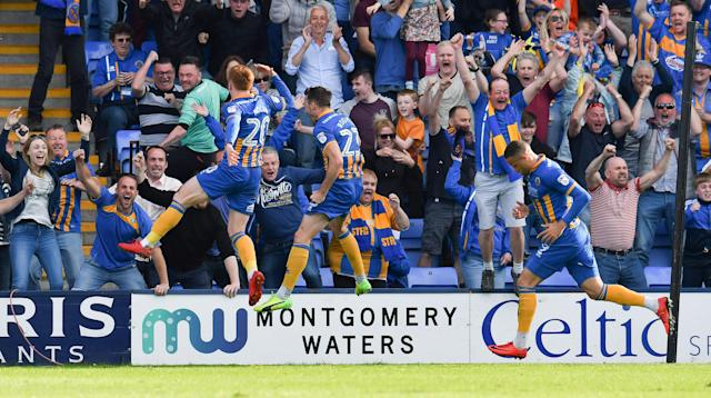"Soccer Football - League One Play Off Semi Final Second Leg - Shrewsbury Town vs Charlton Athletic - Montgomery Waters Meadow, Shrewsbury, Britain - May 13, 2018 Shrewsbury TownÕs Carlton Morris scores their first goal Action Images/Paul Burrows EDITORIAL USE ONLY. No use with unauthorized audio, video, data, fixture lists, club/league logos or ""live"" services. Online in-match use limited to 75 images, no video emulation. No use in betting, games or single club/league/player publications. Please contact your account representative for further details."