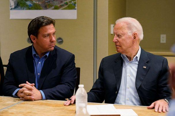 PHOTO: In this July 1, 2021, file photo President Joe Biden, right, looks at Florida Gov. Ron DeSantis, left, during a briefing with first responders and local officials in Miami on the condo tower that collapsed in Surfside, Fla. (Susan Walsh/AP, FILE)