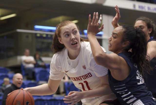 Stanford Ashten Prechtel looks for an open teammate as California Baptists's Tiena Afu defends during the first half of an NCAA college basketball game in Victoria, British Columbia, Thursday, Nov. 28, 2019. (Chad Hipolito/The Canadian Press via AP)