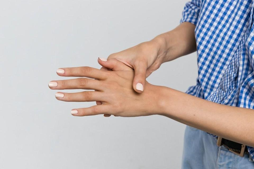 Close-up photo of woman with arm pain, weakness and joint in the hand / osteoarthritis, rheumatoid arthritis, wrist sprain, carpal tunnel syndrome, fracture