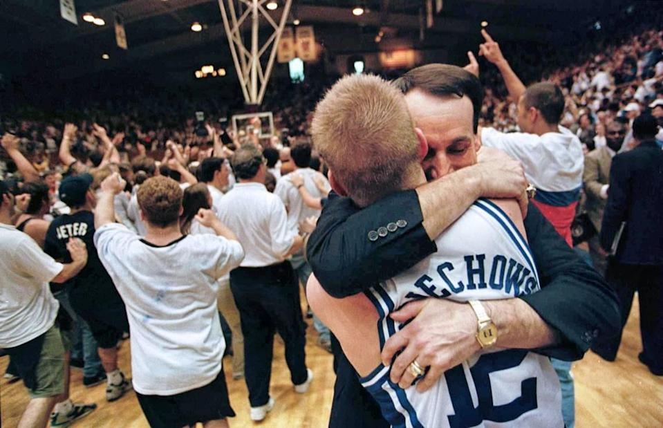 Duke coach Mike Krzyzewski celebrates with senior guard Steve Wojciechowski, who had 11 assists, three steals, and one turnover in the Blue Devils' 77-75 comeback win against North Carolina in 1998.