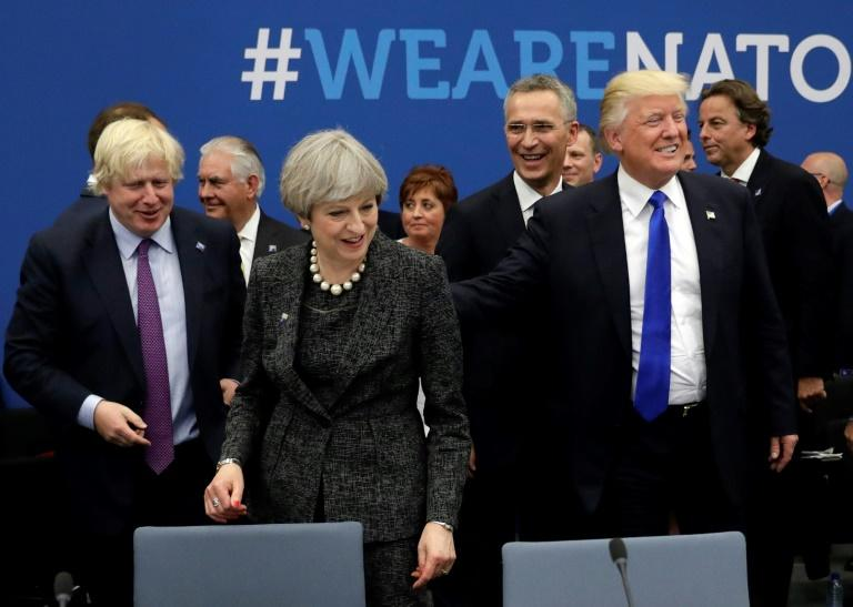 """US President Donald Trump, pictured (right) with Boris Johnson and Theresa May at a NATO meeting in 2017, predicted that the Conservative leadership frontrunner would fix the """"disaster"""" the outgoing British prime minister had made of Brexit"""