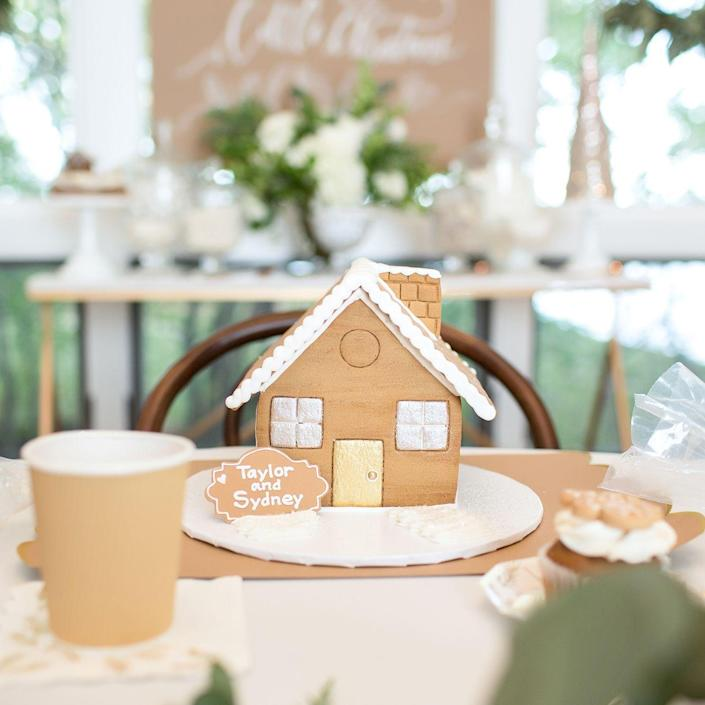 """<p>That's right, decorating <a href=""""https://www.goodhousekeeping.com/holidays/christmas-ideas/g344/gingerbread-houses/"""" rel=""""nofollow noopener"""" target=""""_blank"""" data-ylk=""""slk:gingerbread houses"""" class=""""link rapid-noclick-resp"""">gingerbread houses</a> isn't a just-for-kids activity, says Berger. Pair guests up to form teams and start with pre-built houses to minimize hassle and mess. The decorating portion of the party should have a time limit, followed by an anonymous vote to pick the winners by the end of the party. To give it a grown-up twist, serve spiked hot cocoa!</p>"""