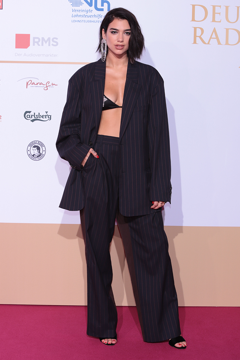 <p>Yesss. This oversized pinstripe suit, spotted at the 2018 Deutscher Radiopreis, is a whole vibe. Especially when paired with that statement earring.</p>