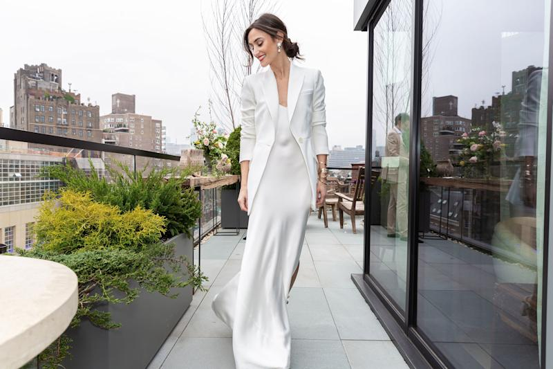 On our terrace in a Dannijo bridal slip, bangles, and earrings. This pic was taken before an intimate legal ceremony in New York City with our immediate family. The couple who set us up officiated which made it really special.