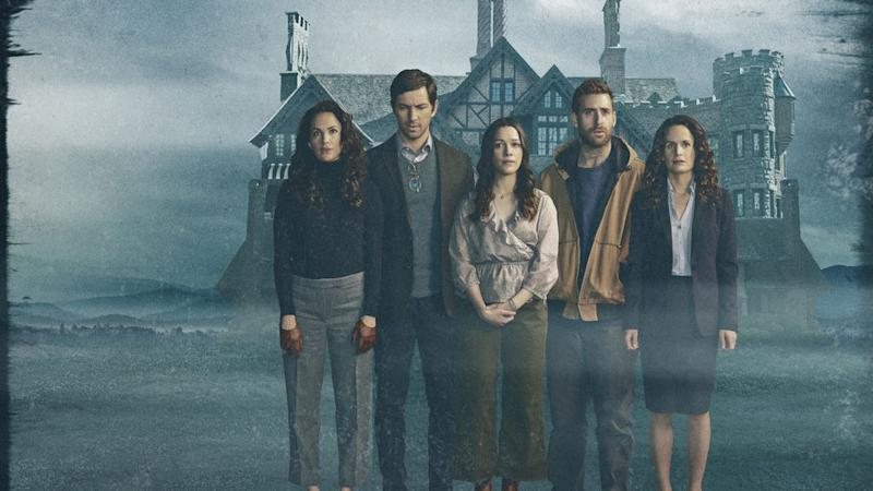 Cast from The Haunting of Hill House in front of Hill House