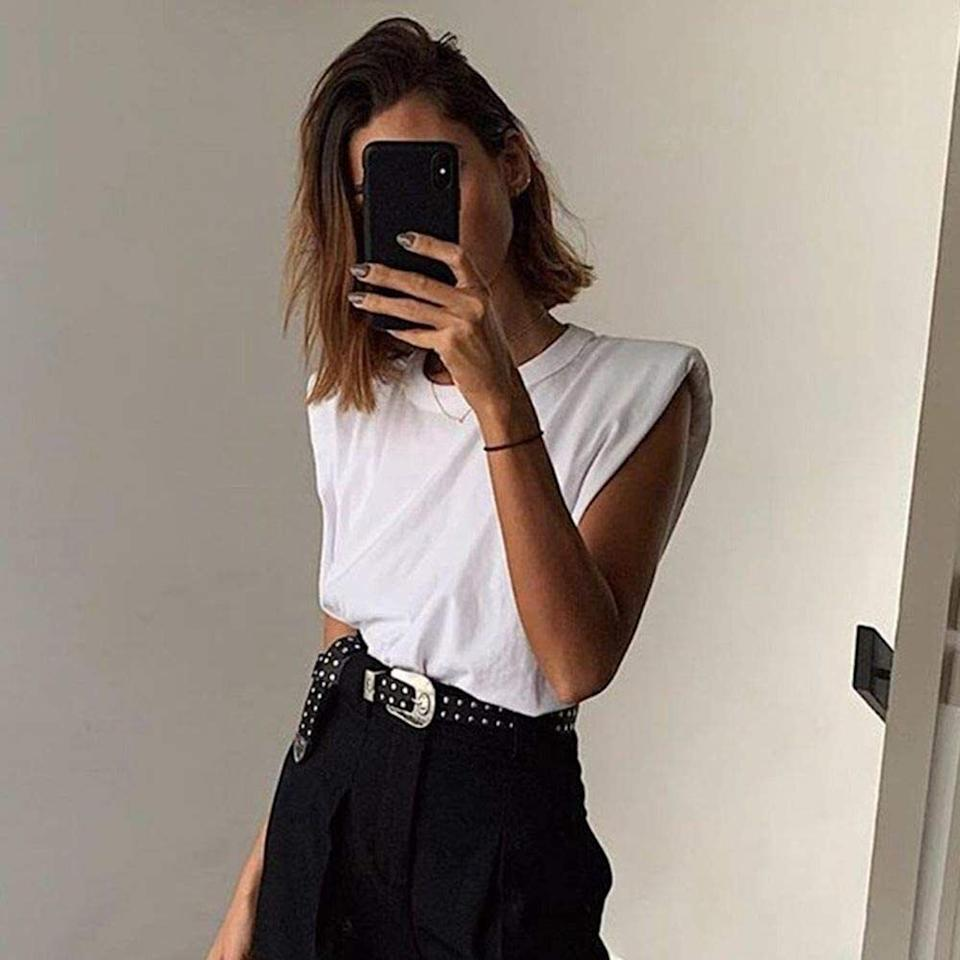 """Made of strokably soft cotton, this top will probably hog all your attention, because there's nothing that this high-end-looking basic can't do. Brunch? Work calls? Dare I say ... dinners with the in-laws? Yes. Yes. And of course, yes.<br /><br /><strong>Promising review:</strong>""""I love this top! This is so similar to the versions that are out from much more expensive retailers right now.<strong>It is so on-trend! I love the muscle tee design and the shoulder pads make it over the top cute.</strong>I got a size medium and I think it's pretty true to size. It has enough length to do a front tuck or you can leave it out."""" —<a href=""""https://www.amazon.com/gp/customer-reviews/R2AHZX1DNM1Q63?&linkCode=ll2&tag=huffpost-bfsyndication-20&linkId=6e5a9bb4d6b69630d5646f79d03664e3&language=en_US&ref_=as_li_ss_tl"""" target=""""_blank"""" rel=""""nofollow noopener noreferrer"""" data-skimlinks-tracking=""""5925990"""" data-vars-affiliate=""""Amazon"""" data-vars-asin=""""none"""" data-vars-href=""""https://www.amazon.com/gp/customer-reviews/R2AHZX1DNM1Q63?tag=bfjasminsandal-20&ascsubtag=5925990%2C14%2C36%2Cmobile_web%2C0%2C0%2C16630228"""" data-vars-keywords=""""cleaning,fast fashion"""" data-vars-link-id=""""16630228"""" data-vars-price="""""""" data-vars-product-id=""""1"""" data-vars-product-img=""""none"""" data-vars-product-title=""""Placeholder- no product"""" data-vars-retailers=""""Amazon"""">Amazon Customer</a><br /><br /><strong><a href=""""https://www.amazon.com/KEALCAFA-Summer-Sleeveless-Shoulder-T-Shirt/dp/B085VFNZG9?&linkCode=ll1&tag=huffpost-bfsyndication-20&linkId=d963bccb0321dcd9b6ca0e0463f6cf39&language=en_US&ref_=as_li_ss_tl"""" target=""""_blank"""" rel=""""noopener noreferrer"""">Get it from Amazon for$19.99+(available in sizes S-XL and nine colors).</a></strong>"""