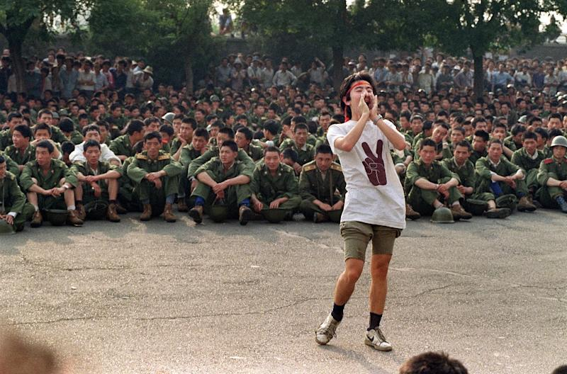 A protesting student asks soldiers to go home as crowds flood into central Beijing on June 3, 1989 (AFP Photo/CATHERINE HENRIETTE)