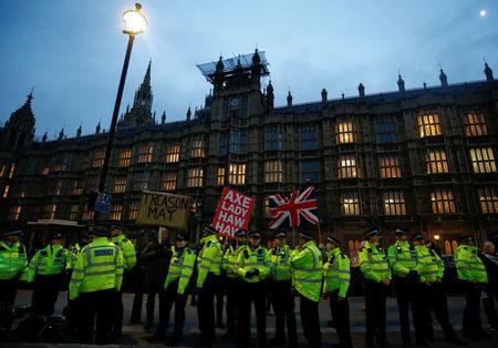 Police officers stand outside the Houses of Parliament, ahead of a vote on Prime Minister Theresa May's Brexit deal, in London, Britain, January 15, 2019. REUTERS/Henry Nicholls