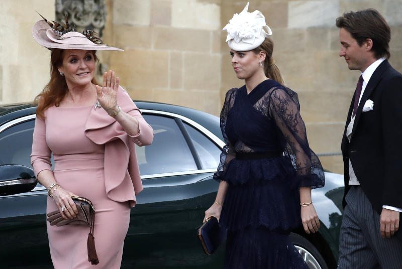 Sarah, Duchess of York (L) waves as she arrives with Britain's Princess Beatrice of York (C) and Edoardo Mapelli Mozzi at St George's Chapel in Windsor Castle, Windsor, west of London, on May 18, 2019, to attend the wedding of Lady Gabriella Windsor to Thomas Kingston. - Lady Gabriella, is the daughter of Prince and Princess Michael of Kent. Prince Michael, is the Queen Elizabeth II's cousin. (Photo by Frank Augstein / POOL / AFP) (Photo credit should read FRANK AUGSTEIN/AFP via Getty Images)