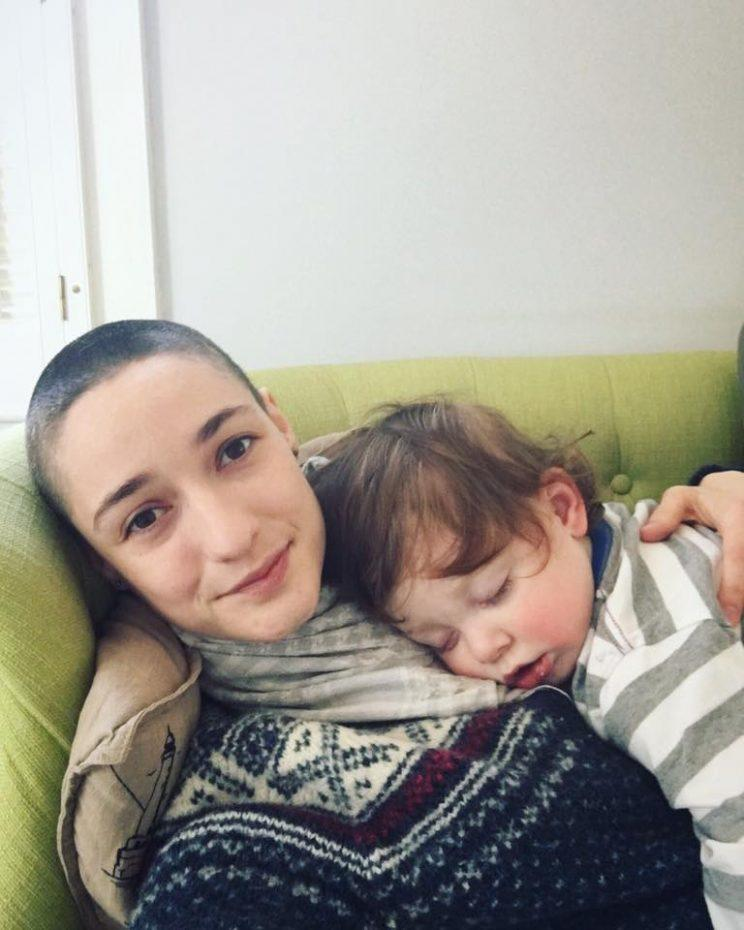 Virginia Mellen, with her freshly shaved head and her son