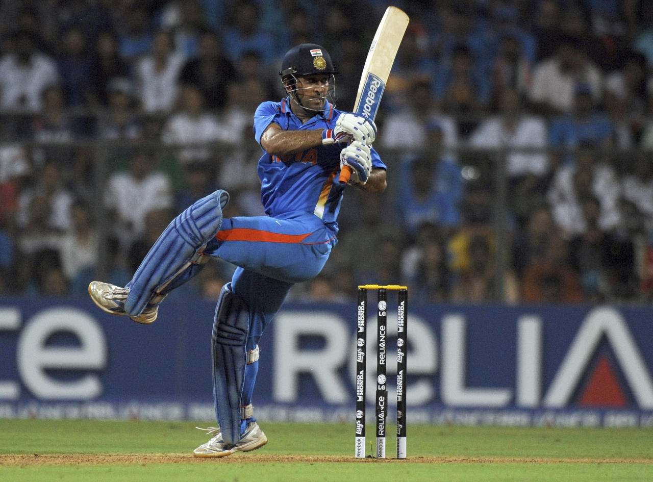 Indian batsman Mahendra Singh Dhoni plays a shot during the ICC Cricket World Cup final between India and Sri Lanka at The Wankhede Stadium in Mumbai on April 2, 2011. AFP PHOTO/Indranil MUKHERJEE (Photo credit should read INDRANIL MUKHERJEE/AFP/Getty Images)