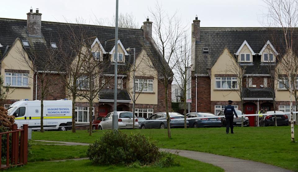 A police officer and police tape surround a house in Newcastle, Dublin, where the children were found.