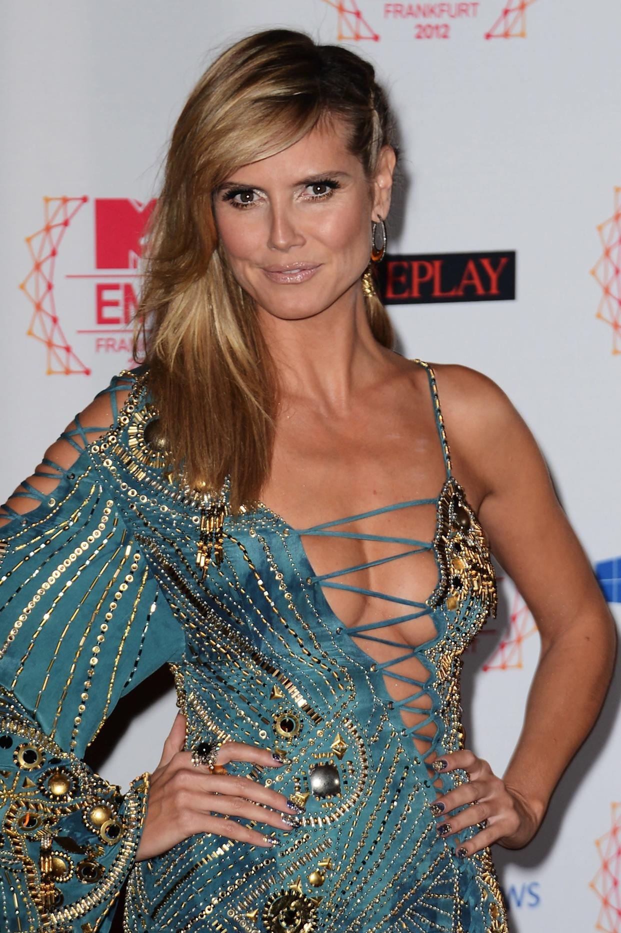 """""""Some people are more experimental in bed and others are more boring. If you are wild and crazy, bring it on so the other person is well aware that you have little devil horns that come out every once in a while,"""" <a href=""""http://www.marieclaire.com/celebrity-lifestyle/celebrities/heidi-klum-feature?click=pp"""" rel=""""nofollow noopener"""" target=""""_blank"""" data-ylk=""""slk:she confessed to Marie Claire"""" class=""""link rapid-noclick-resp"""">she confessed to Marie Claire</a>, adding, """"It's good to make an effort to dress up sometimes, to do things outside of the norm."""""""
