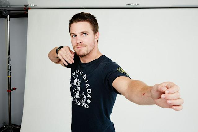"Stephen Amell of ""Arrow"" posing for TV Guide at the 2013 Comic-Con International Convention."