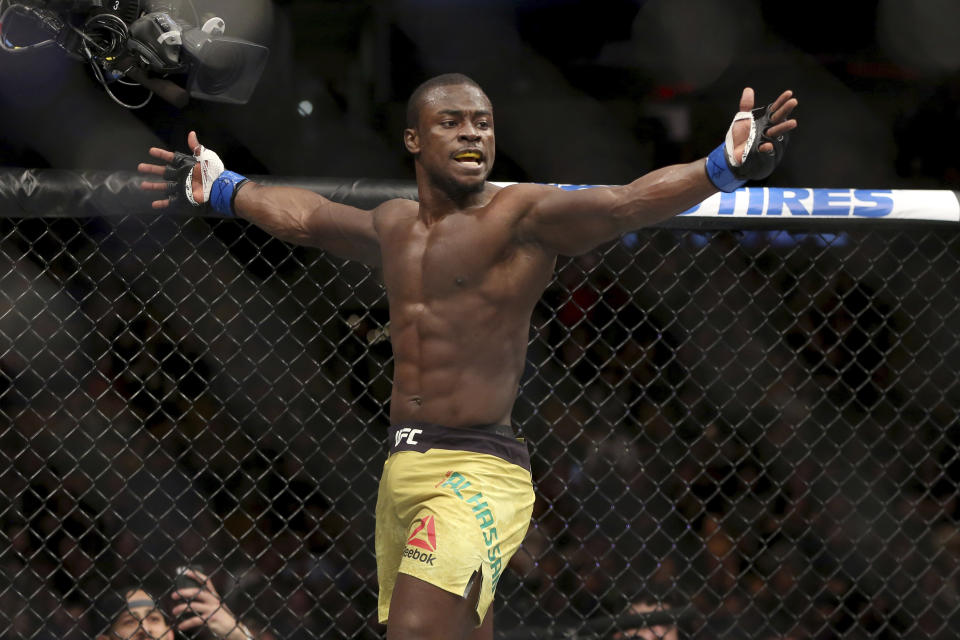 Abdul Razak Alhassan celebrates a knockout of Sabah Homasi after a mixed martial arts bout at UFC 220, Saturday, Jan. 20, 2018, in Boston. Alhassan won via 1st round knockout. (AP Photo/Gregory Payan)