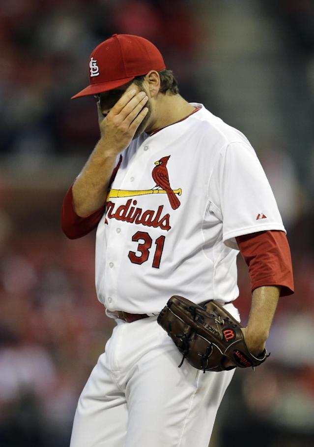 St. Louis Cardinals starting pitcher Lance Lynn pauses after giving up a double to Cincinnati Reds' Brandon Phillips during the first inning of a baseball game Tuesday, April 8, 2014, in St. Louis. (AP Photo/Jeff Roberson)
