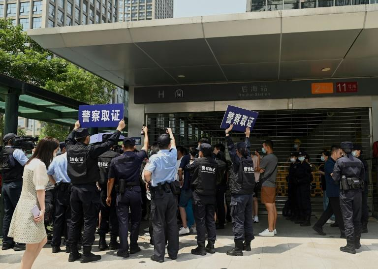 Once a symbol of its might, Evergrande's Shenzhen headquarters is now a besieged barometer of the wide swathe of potential collateral damage, with investors, suppliers and other partners holding daily vigil (AFP/Noel Celis)