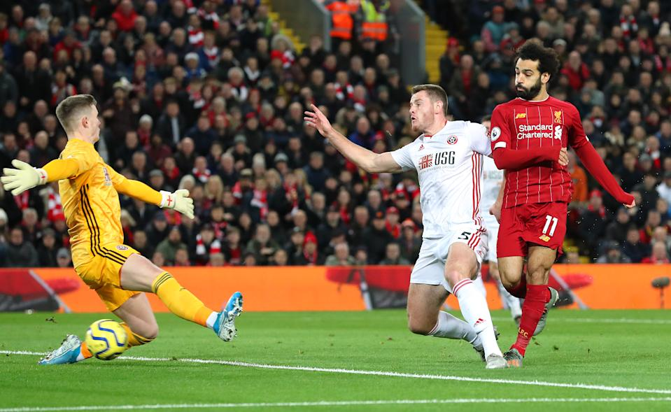 LIVERPOOL, ENGLAND - JANUARY 02:  Mohamed Salah of Liverpool scores the opening goal during the Premier League match between Liverpool FC and Sheffield United at Anfield on January 02, 2020 in Liverpool, United Kingdom. (Photo by Alex Livesey - Danehouse/Getty Images)
