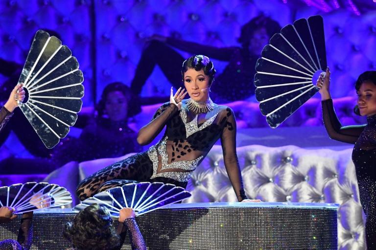 "Cardi B gyrated through her current hit ""Money"" at the Grammys, performing on a rhinestone-encrusted piano"