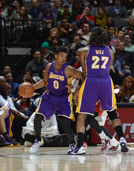 TORONTO, CANADA - January 19: Nick Young #0 of the Los Angeles Lakers looks to pass the ball against the Toronto Raptors during the game on January 19, 2014 at the Air Canada Centre in Toronto, Ontario, Canada. (Photo by Ron Turenne/NBAE via Getty Images)